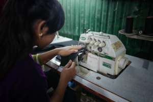 student in the sewing program