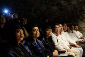 Grads and fellow students watch translator