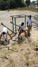 Students assisting in the court restoration