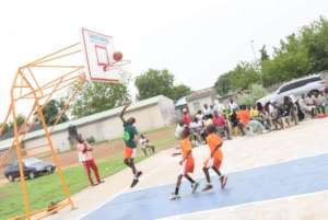 Kids playing at the completed court.