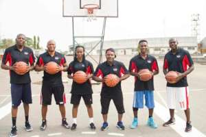 Volunteers Coaches on head to teach the kids