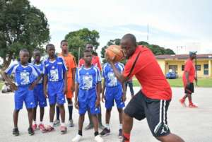 Coach Harrison teaching the boys some basic moves