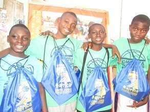 Kids enjoying drawstring bags with school supplies