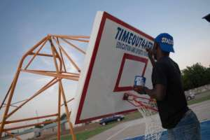 Work on another basketball court upright.