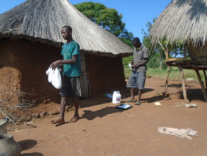 Vectorcide coating being applied inside mud huts