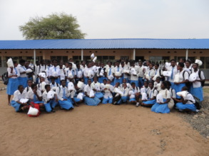 Some of the 1,250 pupils receiving mosquito nets