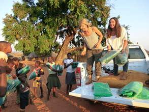 Volunteers Distributing Mosquito Nets