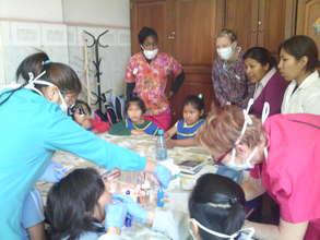 Madre de Dios Shelter children receiving treatment