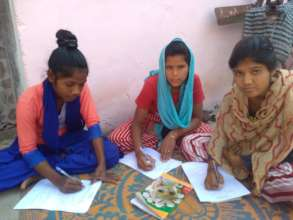Young women conducting survey for action project