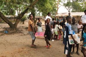 Ebola survivor children happily collect food