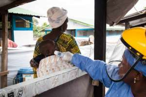 Screening patients at a Guinea hospital
