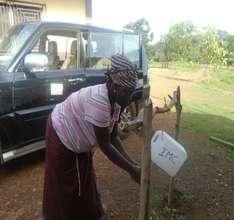Tippy tap in use at Yataya PHU in Koinadugu