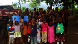 Children happy with gifts donated by REO