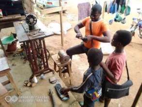children in tailoring workshop