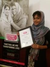 EAG scholar Aisha with her certicate