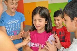 Children play trust building games