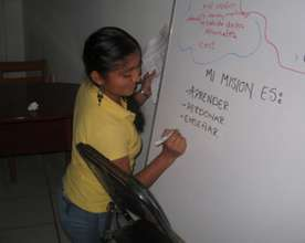 Student writes out her mission statement.