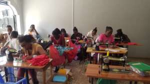 Tailoring students, busy with their assignments.