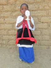 Ouedraogo Bata with her school supplies & lamp
