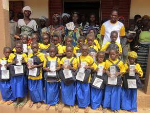 Tenkoaglega girls with school supplies