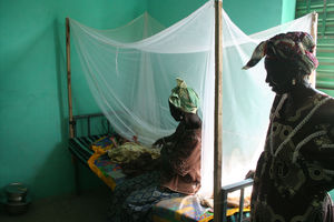 A bed net protects a mother and baby from malaria