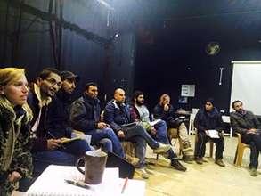 The Siege creative team reading through the script