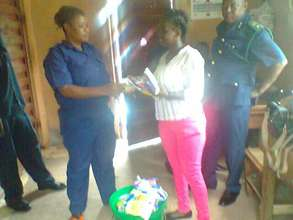 Makeni paralegal with prison officers