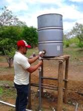 Installing a rain barrel irrigation system
