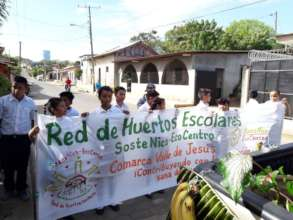 Garden students march in the Mother Earth Parade