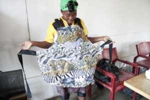 Nonhlanhla modeling an apron she sewed