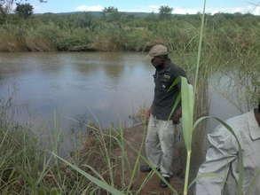 Thokozane checking crawfish traps in the Mbuluzi
