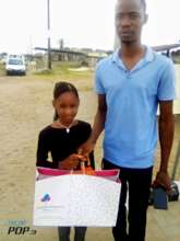 Precious collecting her xmas gift from Bloom Story