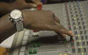 A sound mixing board is adjusted for broadcast.