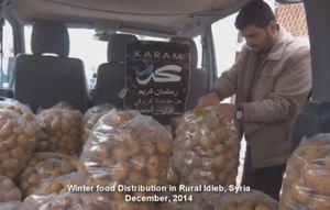 Karam Foundation Distributing Potatoes