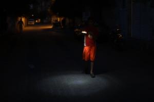 Little Sun:  a child's only light on a dark street