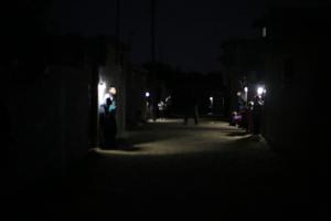 Families illuminate their street with Nur al-Amal
