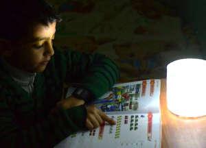 Ameer's nephew: homework w Luci Light in Gaza City