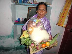 Destitute elder woman with monthly groceries