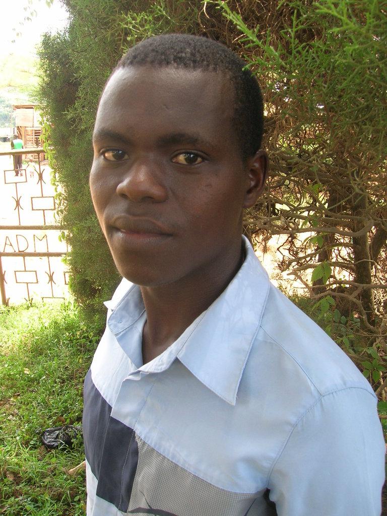 Keep a University boy at school in Uganda
