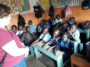 Andria talking to the children at Abundance School