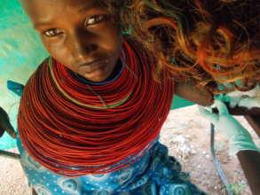 Samburu woman receiving contraceptive