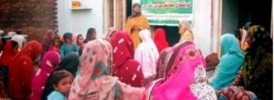 Meeting with women to enroll Girls in School