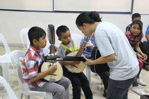 CJFI kids in musical lesson