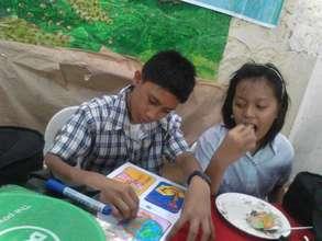 CJFI Kid doing school project