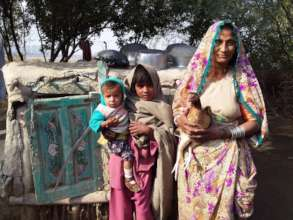 A Bajani Women happy with chicken rearing