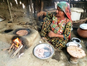 Bajani women cooking Chapati