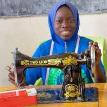 Hadiza at Zarumai model school acquisition event.