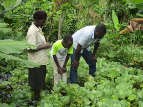 Agronomist and family in new vegetable garden!