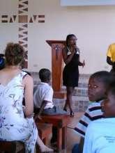 Kerline speaking at celebration