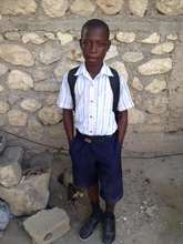 Rodnel proud in his uniform and ready for school